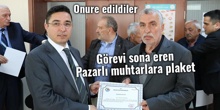 Görevi sona eren Pazarlı muhtarlara plaket