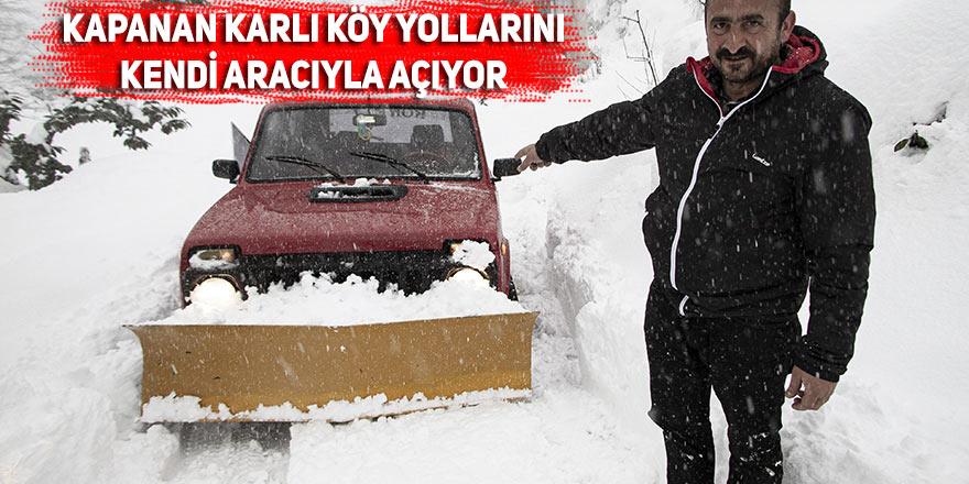 Kapanan karlı köy yolları kendi aracıyla açıyor