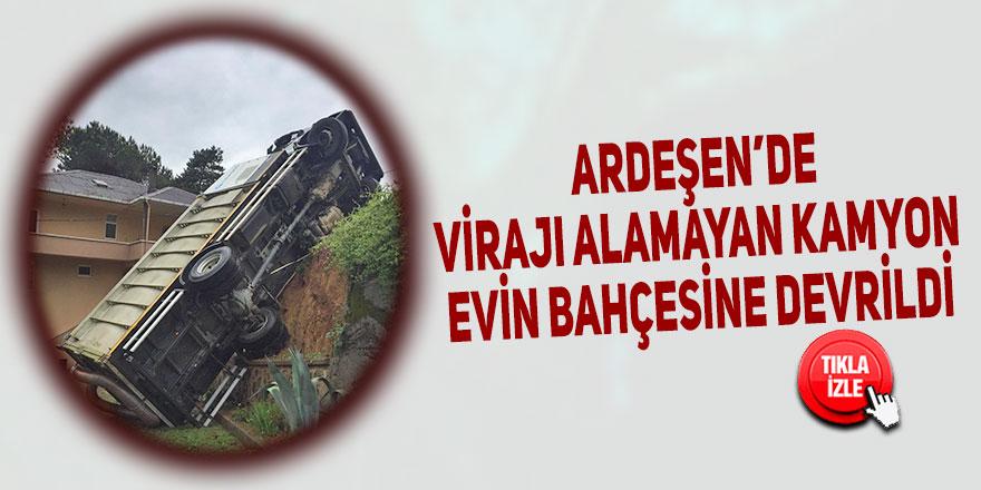 Ardeşen'de virajı alamayan kamyon evin bahçesine devrildi