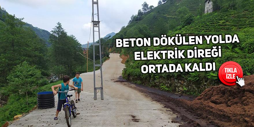 Beton dökülen yolda elektrik direği yolun ortasında kaldı