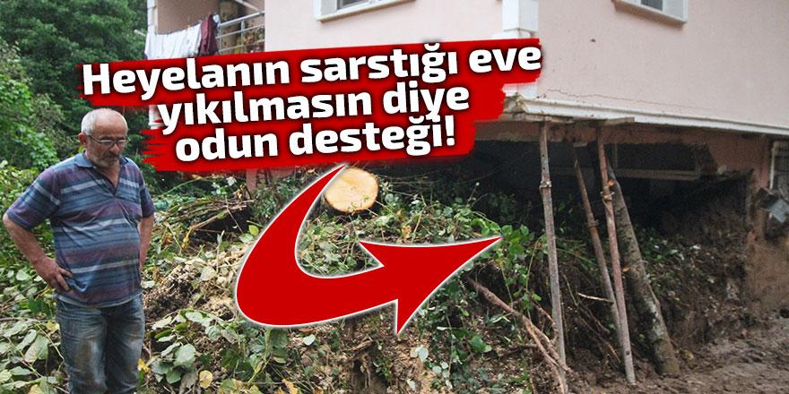 Heyelanın sarstığı eve yıkılmasın diye odun desteği!